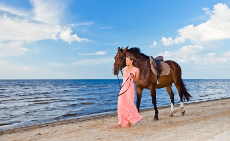 girl on horse: beautiful girl in dress with horse on seacoast