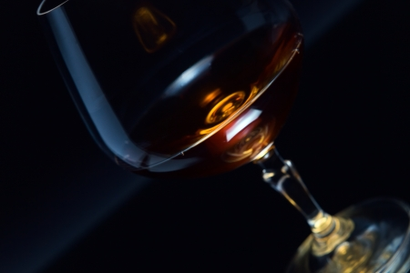 snifter with brandy on a dark background  photo