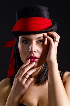 young beautiful woman in black hat with red scarf  photo