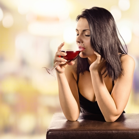 young beautiful woman in bar with red wine  photo