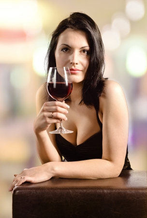 young beautiful woman in bar with red wine  Stock Photo - 19502688