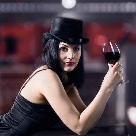 young beautiful woman in black  with red wine Stock Photo - 19502687
