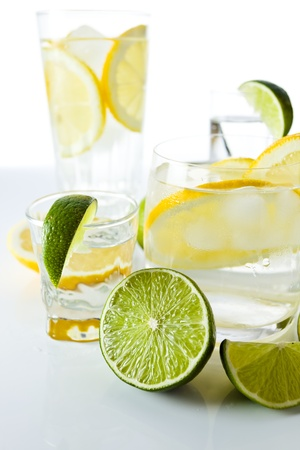 drinks with lemon and lime, shot on reflective  background photo
