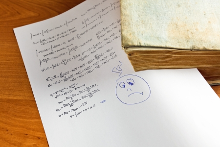 algebraic: Paper with Mathematical formula attached to the old book