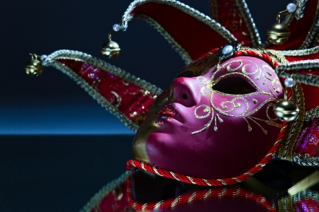 The Venetian mask with bells on a mirror table photo