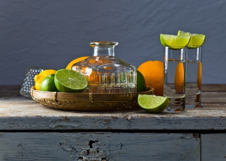 tequila and citrus fruits on a old table photo