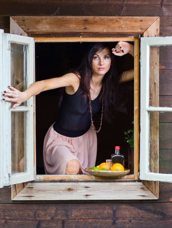 young beautiful woman with tequila and citrus fruits photo