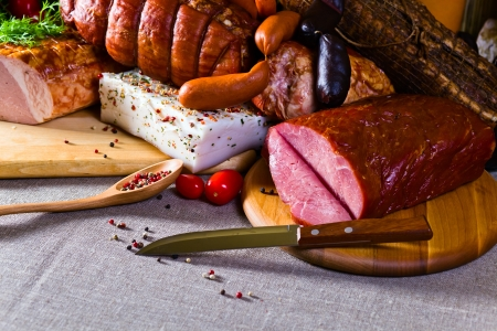 smoked sausage: smoked meat and sausages on a linen cloth