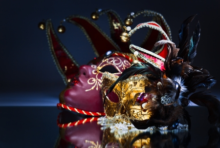Two Venetian masks on a mirror table photo