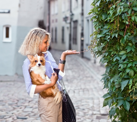 young woman with dog in old city. photo