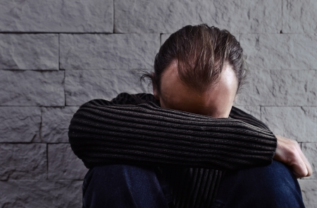 The thoughtful man anxious by problems. Stock Photo