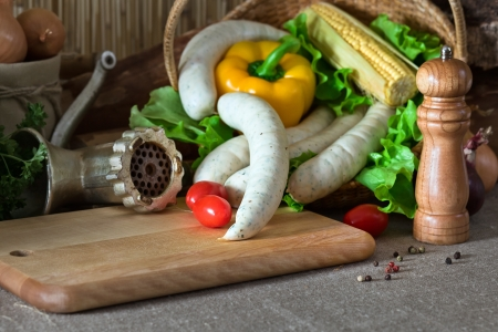 Bavarian sausage and vegetables on a kitchen table Stock Photo - 21963920