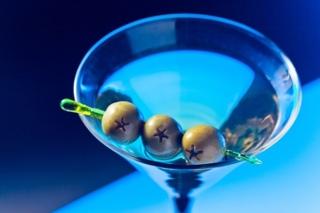 vermouth: martini with green olives , focus on oliwes