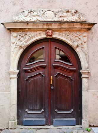 wooden door in old Riga , Latvia photo