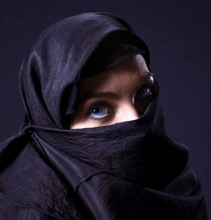 coverlet: The  arabic woman in black coverlet.