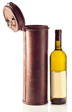 White wine and old wooden case on white background photo
