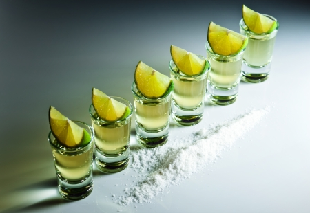 reflexive: tequila , lime and salt on white reflexive background