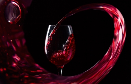 glass with red wine on a black background Фото со стока - 23541248