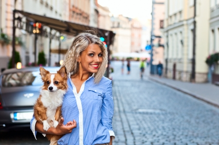 latvia girls:  young woman with chihuahua in old city Stock Photo