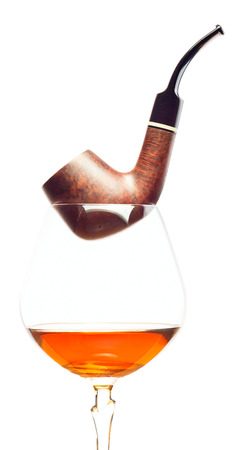 snifter: pipe and snifter with brandy on  white  Stock Photo