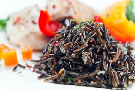 black rice: prepared black rice with meat and vegetables