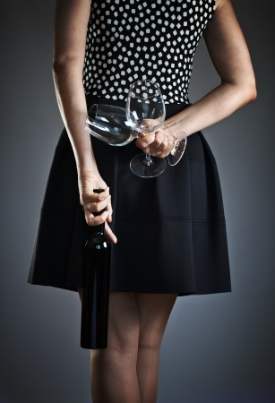 The young woman with  wine and two glasses photo