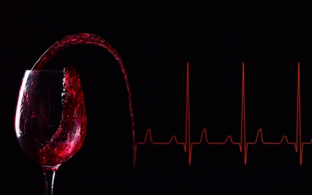 glass with red wine and diagram , red wine well influences heart work photo