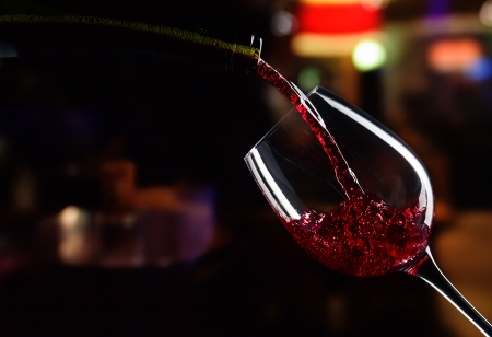 bottle and glass with red wine photo