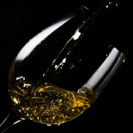 White wine being poured into a wineglass