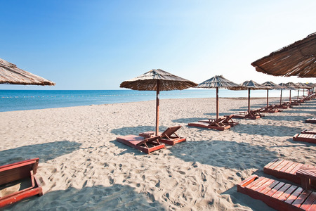 morning , sunbeds and parasols on the beach , Mediterranean sea , Montenegro photo