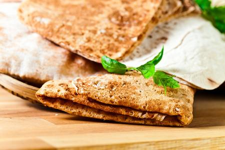 Unleavened wheat cake on wooden table photo