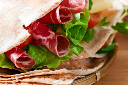 unleavened: unleavened wheat cake  with smoked meat and greens
