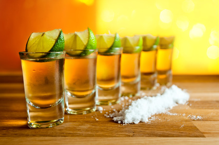 horizontal bar: tequila , lime and salt on wooden table Stock Photo