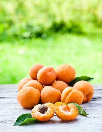 ripe apricots on a old wooden table in garden photo