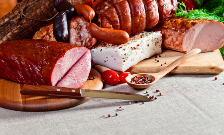 smoked meat and sausages on a linen cloth photo