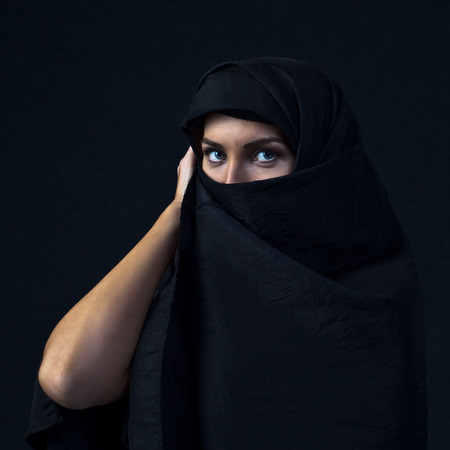 coverlet: The  woman in a black coverlet Stock Photo