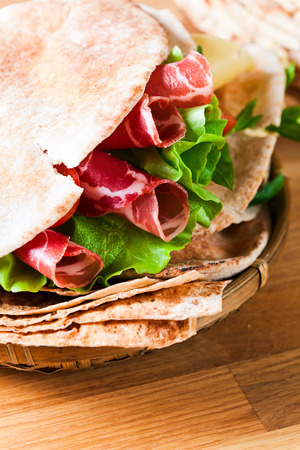 unleavened: unleavened wheat cake  with smoked meat and greens.