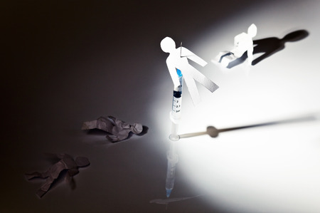 narcotic: The conceptual image on a theme of narcotic dependence, a white reflective background. Stock Photo