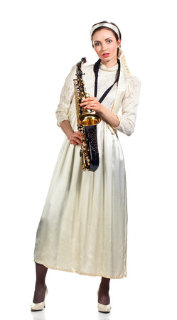 woman with saxophone isolated on white background photo