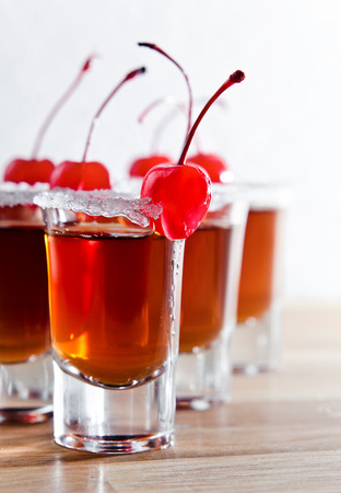 sherry: cherry liquor with berry on wooden table