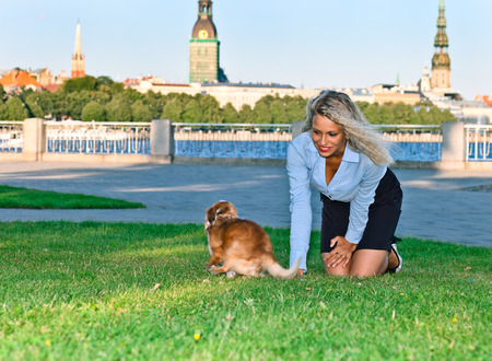 latvia girls: happy blond woman with chihuahua in park Stock Photo