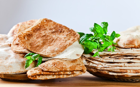 unleavened: Unleavened wheat cake on wooden table