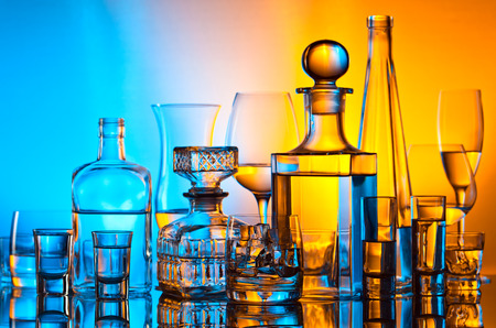 alcohol bottles: alcoholic drinks in bar on glass table  Stock Photo