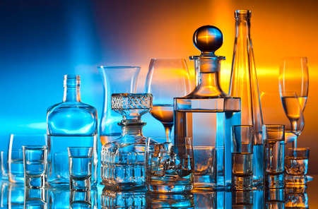 alcoholic drinks in bar on glass table  photo