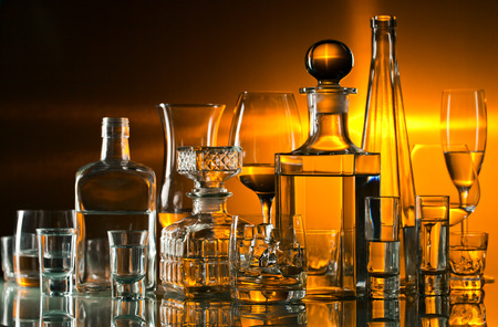 horizontal bar: alcoholic drinks in bar on glass table  Stock Photo