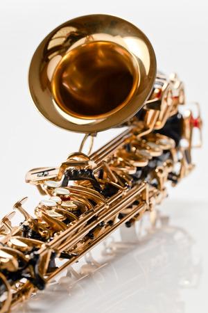 reflexive: closeup of saxophone on white reflexive background