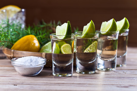 tequila with salt on a old wooden table photo