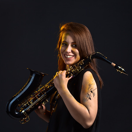 Portrait of the woman in black with a saxophone photo