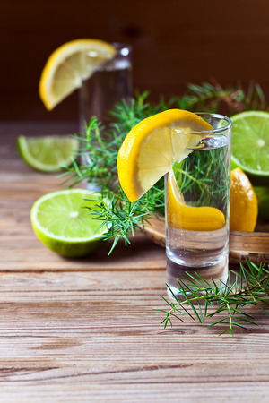 Gin with lemon on a old wooden table photo