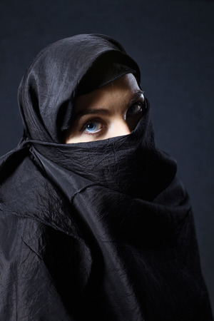 coverlet: The  woman in a black coverlet. Stock Photo